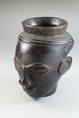 Kuba. <em>Palm Wine Cup in the Form of a Head (Mbwoongntey)</em>, early 20th century. Wood, 4 15/16 x 2 7/8 in. (12.5 x 7.3 cm). Brooklyn Museum, Museum Expedition 1922, Robert B. Woodward Memorial Fund, 22.125. Creative Commons-BY (Photo: Brooklyn Museum, CUR.22.125_threequarter_PS5.jpg)