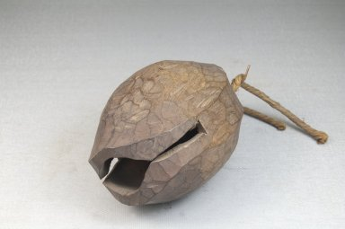 <em>Bell</em>, late 19th or early 20th century. Wood, fiber, 3 1/2 x 2 3/8 in. (8.9 x 6 cm). Brooklyn Museum, Museum Expedition 1922, Robert B. Woodward Memorial Fund, 22.1271. Creative Commons-BY (Photo: Brooklyn Museum, CUR.22.1271_bottom_PS5.jpg)