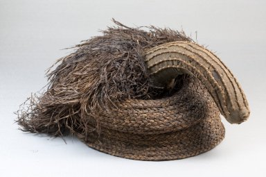 Possibly Kongo. <em>Cap</em>, late 19th century. Raffia, cloth, height: 4 3/4 in. (12 cm); diameter: 7 1/2 in. (19.1 cm). Brooklyn Museum, Museum Expedition 1922, Robert B. Woodward Memorial Fund, 22.1284. Creative Commons-BY (Photo: Brooklyn Museum, CUR.22.1284_front_PS5.jpg)