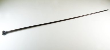 <em>Cane</em>, late 19th century. Wood, 35 1/4 x 1 1/4 in. (89.5 x 3.2 cm). Brooklyn Museum, Gift of Thomas A. Eddy, 22.1311. Creative Commons-BY (Photo: Brooklyn Museum, CUR.22.1311_threequarter_PS5.jpg)