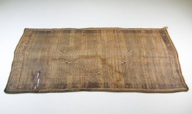Kongo. <em>Mat</em>, late 19th century. Rattan, 13 3/8 x 24 13/16 in. (34 x 63 cm). Brooklyn Museum, Museum Expedition 1922, Robert B. Woodward Memorial Fund, 22.1325. Creative Commons-BY (Photo: Brooklyn Museum, CUR.22.1325_front_PS5.jpg)