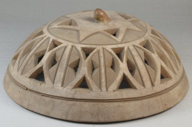 <em>Gourd Cover</em>, before 1922. Gourd, height: 3 9/16 in. (9 cm); diameter: 8 7/8 in. (22.5 cm). Brooklyn Museum, Museum Expedition 1922, Robert B. Woodward Memorial Fund, 22.1352. Creative Commons-BY (Photo: Brooklyn Museum, CUR.22.1352_front_PS5.jpg)