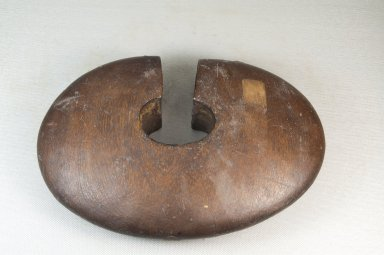 Tutsi. <em>Wrist Guard (Igitembe)</em>, first half of 20th century. Wood, copper alloy, 6 x 9 x 2 1/8 in. (15.2 x 22.9 x 5.4 cm). Brooklyn Museum, Museum Expedition 1922, Robert B. Woodward Memorial Fund, 22.1403. Creative Commons-BY (Photo: Brooklyn Museum, CUR.22.1403_front_PS5.jpg)