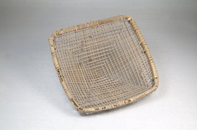 <em>Plaited Basket Sieve with Handle</em>. Vegetal fiber, 6 x 6 x 2 1/4 in. (15.2 x 15.2 x 5.7 cm). Brooklyn Museum, Museum Expedition 1922, Robert B. Woodward Memorial Fund, 22.1407. Creative Commons-BY (Photo: Brooklyn Museum, CUR.22.1407_front_PS5.jpg)