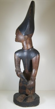 Possibly Kongo. <em>Figure of Man with Knife</em>, 19th or 20th century. Wood, pigment, ceramic, 38 x 10 3/4 in. (96.5 x 27.3 cm). Brooklyn Museum, Museum Expedition 1922, Robert B. Woodward Memorial Fund, 22.1410. Creative Commons-BY (Photo: Brooklyn Museum, CUR.22.1410_front_ps5.jpg)