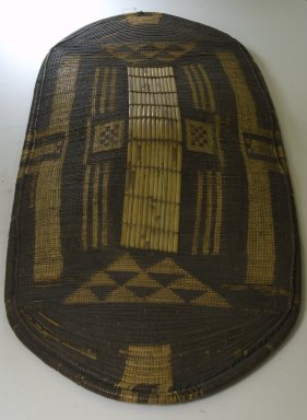 Zande. <em>Shield</em>, late 19th-early 20th century. Wood, fiber, 45 1/4 x 20 1/2 in. (114.9 x 52.1 cm). Brooklyn Museum, Museum Expedition 1922, Robert B. Woodward Memorial Fund, 22.1416. Creative Commons-BY (Photo: Brooklyn Museum, CUR.22.1416_front_PS5.jpg)