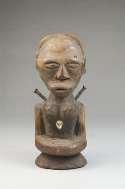 Songye. <em>Half Figure</em>, late 19th or early 20th century. Wood, iron, tooth, 5 1/4 x 2 1/4 x 2 in. (13.3 x 5.7 x 5.1 cm). Brooklyn Museum, Museum Expedition 1922, Robert B. Woodward Memorial Fund, 22.1433. Creative Commons-BY (Photo: Brooklyn Museum, CUR.22.1433_front_PS5.jpg)