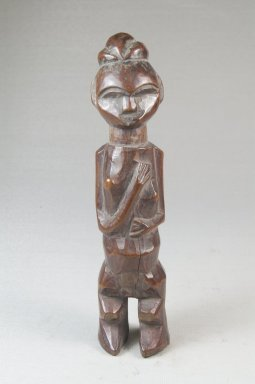 Yaka. <em>Standing Female Figure</em>, 19th century. Wood, 6 3/4 x 1 1/2 x 1 1/4 in. (17.0 x 4.0 x 3.2 cm). Brooklyn Museum, Museum Expedition 1922, Robert B. Woodward Memorial Fund, 22.1438. Creative Commons-BY (Photo: Brooklyn Museum, CUR.22.1438_front_PS5.jpg)