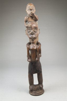 Possibly Mbala. <em>Piggy Back Figure</em>, late 19th or early 20th century. Wood, pigment, 10 1/2 x 2 x 2 1/4 in. (26.8 x 5.0 x 5.5 cm). Brooklyn Museum, Museum Expedition 1922, Robert B. Woodward Memorial Fund, 22.1439. Creative Commons-BY (Photo: Brooklyn Museum, CUR.22.1439_front_PS5.jpg)