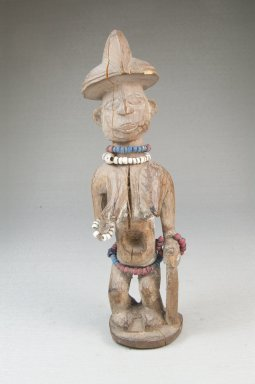 Yaka. <em>Female Figure Standing with Cane</em>, 20th century. Wood, plastic beads, 7 1/4 x 2 x 2 in. (18.0 x 5.0 x 5.0 cm). Brooklyn Museum, Museum Expedition 1922, Robert B. Woodward Memorial Fund, 22.1445. Creative Commons-BY (Photo: Brooklyn Museum, CUR.22.1445_front_PS5.jpg)
