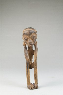 Lulua. <em>Figure of a Squatting Male</em>, early 20th century. Wood, 4 1/2 x 1 1/4 x 1 1/4 in. (11.4 x 3.2 x 3.2 cm). Brooklyn Museum, Museum Expedition 1922, Robert B. Woodward Memorial Fund, 22.1448. Creative Commons-BY (Photo: Brooklyn Museum, CUR.22.1448_front_PS5.jpg)