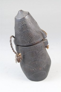 Kongo. <em>Powder Box (Tutukipfula)</em>, late 19th-early 20th century. Wood, cord, height: 5 1/4 in. (13.3 cm); diameter: 2 1/2 in. (6.4 cm). Brooklyn Museum, Museum Expedition 1922, Robert B. Woodward Memorial Fund, 22.144. Creative Commons-BY (Photo: Brooklyn Museum, CUR.22.144_front_PS5.jpg)