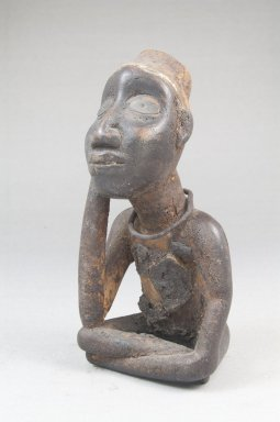Vili. <em>Seated Male Figure</em>, late 19th or early 20th century. Wood, shell, metal, resin, pigment, 5 x 2 1/8 x 2 3/4 in. (12.5 x 5.5 x 7.0 cm). Brooklyn Museum, Museum Expedition 1922, Robert B. Woodward Memorial Fund, 22.1450. Creative Commons-BY (Photo: Brooklyn Museum, CUR.22.1450_threequarter_PS5.jpg)