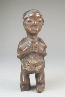 Mbala. <em>Standing Female Figure</em>, 19th or early 20th century. Wood, fiber, organic materials, 6 7/8 x 2 1/4 x 2in. (17.5 x 5.7 x 5.1cm). Brooklyn Museum, Museum Expedition 1922, Robert B. Woodward Memorial Fund, 22.1451. Creative Commons-BY (Photo: Brooklyn Museum, CUR.22.1451_front_PS5.jpg)