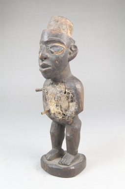 Vili. <em>Standing Male Figure (Nkonde)</em>, 19th century. Wood, resin, glass mirror, ferrous nails, 7 3/4 x 2 1/2 x 2in. (19.7 x 6.4 x 5.1cm). Brooklyn Museum, Museum Expedition 1922, Robert B. Woodward Memorial Fund, 22.1458. Creative Commons-BY (Photo: Brooklyn Museum, CUR.22.1458_threequarter_PS5.jpg)