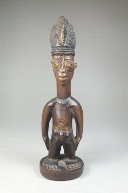 Yorùbá artist. <em>Figure of a Standing Male (Ere Ibeji)</em>, late 19th or early 20th century. Wood, 10 1/2 in. (24.5 x 7 cm). Brooklyn Museum, Robert B. Woodward Memorial Fund, 22.1459. Creative Commons-BY (Photo: Brooklyn Museum, CUR.22.1459_front_PS5.jpg)