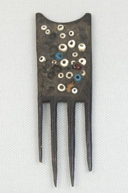 Possibly Luba. <em>Comb</em>. Wood, beads, 4 5/16 x 1 3/8 in. (11 x 3.5 cm). Brooklyn Museum, Museum Expedition 1922, Robert B. Woodward Memorial Fund, 22.1473. Creative Commons-BY (Photo: Brooklyn Museum, CUR.22.1473_front_PS5.jpg)