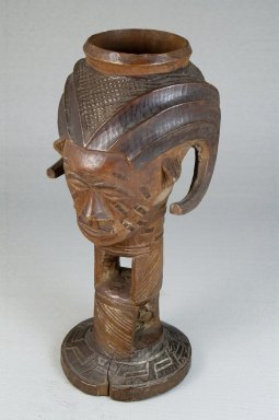 Kuba (Bushoong subgroup). <em>Single Head Goblet (Mbwoongntey)</em>, early 20th century. Wood, 8 1/16 x 3 1/2 in. (20.5 x 8.9 cm). Brooklyn Museum, Museum Expedition 1922, Robert B. Woodward Memorial Fund, 22.1485. Creative Commons-BY (Photo: Brooklyn Museum, CUR.22.1485_threequarter_PS5.jpg)