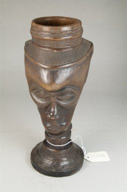 Kuba (Bushoong subgroup). <em>Single Head Goblet (Mbwoongntey)</em>, early 20th century. Wood, 8 1/4 x 4 5/16 in. (21 x 11 cm). Brooklyn Museum, Museum Expedition 1922, Robert B. Woodward Memorial Fund, 22.1486. Creative Commons-BY (Photo: Brooklyn Museum, CUR.22.1486_front_PS5.jpg)