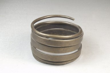 <em>Plain Spiral Armlet</em>. Brass Brooklyn Museum, Museum Expedition 1922, Robert B. Woodward Memorial Fund, 22.1532. Creative Commons-BY (Photo: Brooklyn Museum, CUR.22.1532_front_PS5.jpg)