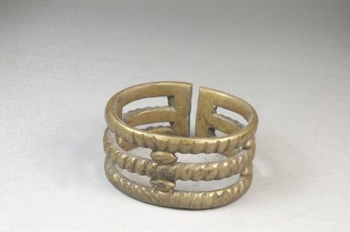 <em>Cast Bracelet</em>. Brass Brooklyn Museum, Museum Expedition 1922, Robert B. Woodward Memorial Fund, 22.1534. Creative Commons-BY (Photo: Brooklyn Museum, CUR.22.1534_front_PS5.jpg)