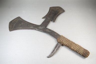 Ngombe. <em>Throwing Knife</em>, 19th century. Iron, fiber, 9 1/16 x 17 5/16 in. (23 x 44 cm). Brooklyn Museum, Museum Expedition 1922, Robert B. Woodward Memorial Fund, 22.1564. Creative Commons-BY (Photo: Brooklyn Museum, CUR.22.1564_top_PS5.jpg)
