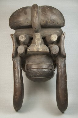 We. <em>Mask</em>, 19th century. Wood, vegetable material, pigment, vegetable twine, ferrous nails, 17 x 8 3/4 x 6 3/4 in. (43.2 x 22.2 x 17.1 cm). Brooklyn Museum, Museum Expedition 1922, Robert B. Woodward Memorial Fund, 22.1591. Creative Commons-BY (Photo: Brooklyn Museum, CUR.22.1591_front_PS5.jpg)
