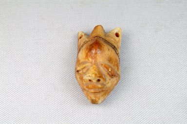 Pende. <em>Pendant: mask (gikhoko)</em>. Ivory, 2 5/16 x 1 5/16 in. (5.8 x 3.4 cm). Brooklyn Museum, Museum Expedition 1922, Robert B. Woodward Memorial Fund, 22.1599. Creative Commons-BY (Photo: Brooklyn Museum, CUR.22.1599_front_PS5.jpg)