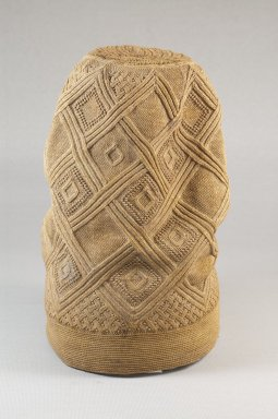Kongo. <em>Hat (Mpu)</em>, late 19th century. Fiber, 9 x 5 1/8 x 5 1/8 in.  (22.9 x 13.0 x 13.0 cm). Brooklyn Museum, Brooklyn Museum Collection, 22.1610. Creative Commons-BY (Photo: Brooklyn Museum, CUR.22.1610_front_PS5.jpg)