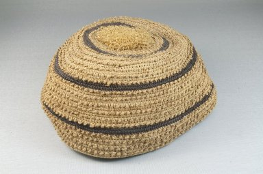 Kongo. <em>Basketry Cap</em>, late 19th-early 20th century. Raffia fiber, brown bands, Height: 3 1/8in. (7.9cm.). Brooklyn Museum, Museum Expedition 1922, Robert B. Woodward Memorial Fund, 22.1619. Creative Commons-BY (Photo: Brooklyn Museum, CUR.22.1619_front_PS5.jpg)