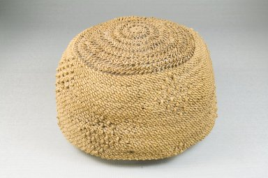 Possibly Kongo. <em>Basketry Cap</em>, late 19th-early 20th century. Raffia, fiber, height: 3 1/8 in. (7.9 cm); diameter: 6 1/4 in. (15.9 cm). Brooklyn Museum, Brooklyn Museum Collection, 22.1620. Creative Commons-BY (Photo: Brooklyn Museum, CUR.22.1620_front_PS5.jpg)