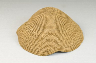 Kuba. <em>Basketry Cap (Laket)</em>, late 19th-early 20th century. Raffia, height: 2 in. (5.1 cm); diameter: 5 1/2 in. (14 cm). Brooklyn Museum, Museum Expedition 1922, Robert B. Woodward Memorial Fund, 22.1625. Creative Commons-BY (Photo: Brooklyn Museum, CUR.22.1625_front_PS5.jpg)