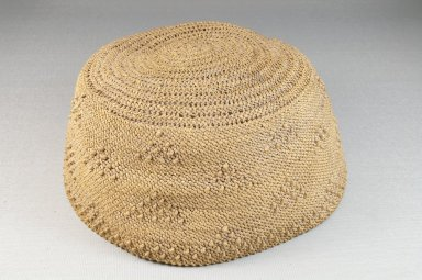 Kongo. <em>Basketry Cap</em>, late 19th or early 20th century. Raffia, height: 3 1/8 in. (7.9 cm); diameter: 6 in. (15.2 cm). Brooklyn Museum, Brooklyn Museum Collection, 22.1626. Creative Commons-BY (Photo: Brooklyn Museum, CUR.22.1626_front_PS5.jpg)