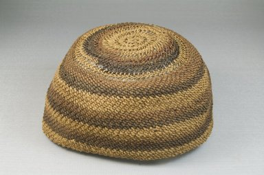 Yombe. <em>Basketry Cap (Mpu)</em>, late 19th-early 20th century. Raffia, height: 3 1/8 in. (8 cm); diameter: 5 7/8 in. (14.9 cm). Brooklyn Museum, Museum Expedition 1922, Robert B. Woodward Memorial Fund, 22.1627. Creative Commons-BY (Photo: Brooklyn Museum, CUR.22.1627_front_PS5.jpg)