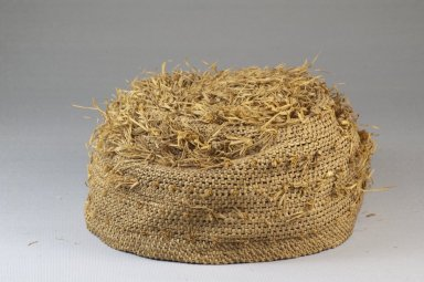 Possibly Kongo. <em>Basketry Cap</em>, late 19th century. Fiber, raffia, height: 3 1/8 in. (7.9 cm); diameter: 6 5/16 in. (16 cm). Brooklyn Museum, Museum Expedition 1922, Robert B. Woodward Memorial Fund, 22.1644. Creative Commons-BY (Photo: Brooklyn Museum, CUR.22.1644_front_PS5.jpg)
