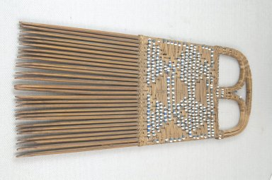 <em>Comb</em>, late 19th or early 20th century. Wood, fiber, 9 5/8 x 4 in. (24.4 x 10.2 cm). Brooklyn Museum, Museum Expedition 1922, Robert B. Woodward Memorial Fund, 22.1657. Creative Commons-BY (Photo: Brooklyn Museum, CUR.22.1657_front_PS5.jpg)