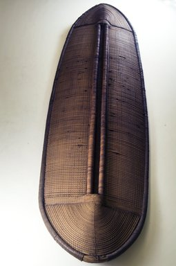 Buaka. <em>Shield</em>, 19th century. Wood, fiber, 50 x 13 3/4 in. (127 x 34.9 cm). Brooklyn Museum, Museum Expedition 1922, Robert B. Woodward Memorial Fund, 22.1687. Creative Commons-BY (Photo: Brooklyn Museum, CUR.22.1687_front_PS5.jpg)