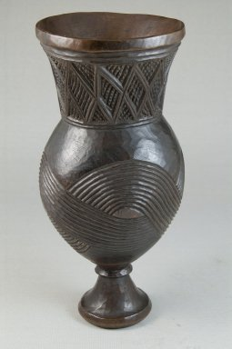 Wongo. <em>Goblet</em>, early 20th century. Wood, 8 1/4 x 3 11/16 x 3 11/16 in. (21 x 9.4 x 9.4 cm). Brooklyn Museum, Museum Expedition 1922, Robert B. Woodward Memorial Fund, 22.175. Creative Commons-BY (Photo: Brooklyn Museum, CUR.22.175_front_PS5.jpg)