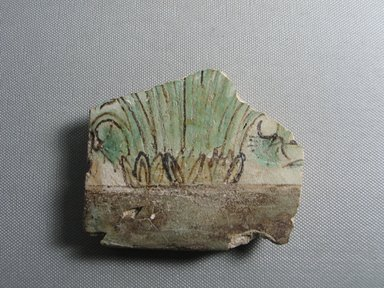 <em>Fragmentary Tile</em>, ca. 1352-1332 B.C.E. Faience, 3 1/16 × 3 3/4 × 9/16 in. (7.8 × 9.5 × 1.4 cm). Brooklyn Museum, Gift of the Egypt Exploration Society, 22.1917. Creative Commons-BY (Photo: , CUR.22.1917_view01.jpg)