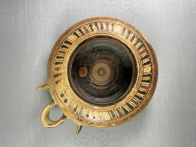 Greek. <em>Circular Pot</em>, 575-550 B.C.E. Clay, slip, 2 3/16 x Diam. of body 6 3/16 in. (5.5 x 15.7 cm). Brooklyn Museum, Gift of Mrs. Frederic H. Betts, 22.19. Creative Commons-BY (Photo: Brooklyn Museum, CUR.22.19_view01.jpg)