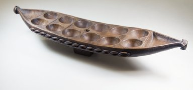 Possibly Bullom. <em>Mancala Game Board</em>, late 19th century. Wood, 25 3/4 x 5 1/2 x 6 1/2 in.  (65.4 x 14 x 16.5 cm). Brooklyn Museum, Museum Expedition 1922, Robert B. Woodward Memorial Fund, 22.213. Creative Commons-BY (Photo: Brooklyn Museum, CUR.22.213_threequarter_PS5.jpg)
