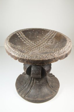 Mangbetu. <em>Stool</em>, late 19th or early 20th century. Wood, copper alloy, 11 13/16 x 12 3/16 x 12 3/16 in. (30 x 31 x 31 cm). Brooklyn Museum, Museum Expedition 1922, Robert B. Woodward Memorial Fund, 22.232. Creative Commons-BY (Photo: Brooklyn Museum, CUR.22.232_front_PS5.jpg)
