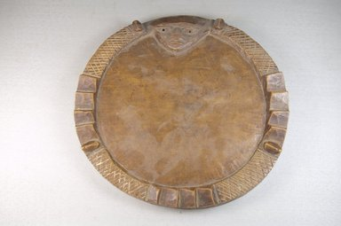 Yorùbá. <em>Divination Board (Pako Ifa)</em>, late 19th century. Wood, 3/4 x 9 5/8 x 9 5/8 in. (1.9 x 24.4 x 24.4 cm). Brooklyn Museum, Museum Expedition 1922, Robert B. Woodward Memorial Fund