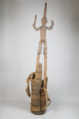 Duahn Yibay (Dan, flourished 1920s-1930s). <em>Figure of a Male Stilt Dancer Holding Knife and Horn</em>, late 19th or early 20th century. Copper alloy, fiber, 24 1/4 x 4 3/4 x 3in. (61.6 x 12.1 x 7.6cm). Brooklyn Museum, Museum Expedition 1922, Robert B. Woodward Memorial Fund, 22.272. Creative Commons-BY (Photo: Brooklyn Museum, CUR.22.272_front_PS5.jpg)