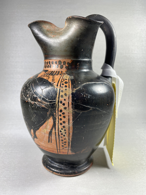 Attributed to Red Line Painter. <em>Black-Figure Oinochoe</em>, ca. 500 B.C.E. Clay, slip, 8 1/4 x Diam. of body 5 1/4 in. (21 x 13.4 cm). Brooklyn Museum, Gift of Mrs. Frederic H. Betts, 22.27. Creative Commons-BY (Photo: Brooklyn Museum, CUR.22.27_view01.jpg)
