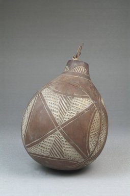 <em>Calabash</em>, before 1922. Calabash, clay, height: 4 1/2 in. (11.5 cm); diameter: 3 9/16 in. (9 cm). Brooklyn Museum, Museum Expedition 1922, Robert B. Woodward Memorial Fund, 22.374. Creative Commons-BY (Photo: Brooklyn Museum, CUR.22.374_front_PS5.jpg)