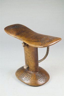 Turkana. <em>Headrest</em>, late 19th or early 20th century. Wood, leather, 5 1/8 x 6 3/4 x 3 1/4 in. (13 x 17.1 x 8.3 cm). Brooklyn Museum, Museum Expedition 1922, Robert B. Woodward Memorial Fund, 22.376. Creative Commons-BY (Photo: Brooklyn Museum, CUR.22.376_threequarter_PS5.jpg)