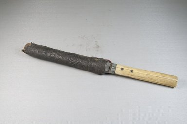 <em>Knife with Scabbard</em>, 19th-20th century. Iron, bone, wood, leather, 1 5/16 x 11 3/16 in. (3.3 x 28.4 cm). Brooklyn Museum, Museum Expedition 1922, Robert B. Woodward Memorial Fund, 22.450a-b. Creative Commons-BY (Photo: Brooklyn Museum, CUR.22.450a-b_assembled_PS5.jpg)