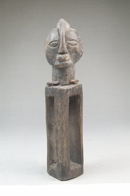 Yaka. <em>Figure with Hollow Rectangular Body</em>, 19th century. Wood, iron, 5 1/2 x 1 1/4 x 2 in. (14.0 x 3.2 x 5.0 cm). Brooklyn Museum, Museum Expedition 1922, Robert B. Woodward Memorial Fund, 22.475. Creative Commons-BY (Photo: Brooklyn Museum, CUR.22.475_front_PS5.jpg)