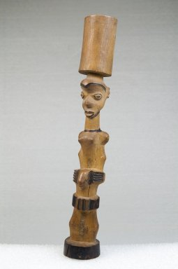 Nsapo-Nsapo. <em>Mortar with Female Figure</em>, late 19th or early 20th century. Wood, pigment, 8 x 1 1/4 x 1 1/4 in. (20.3 x 3.2 x 3.2 cm). Brooklyn Museum, Museum Expedition 1922, Robert B. Woodward Memorial Fund, 22.480. Creative Commons-BY (Photo: Brooklyn Museum, CUR.22.480_threequarter_PS5.jpg)